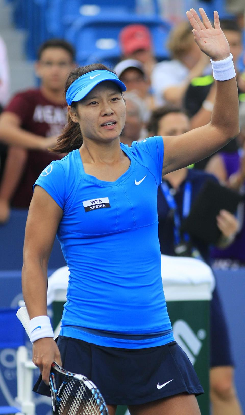Li Na, of China, acknowledges the crowd after defeating Angelique Kerber, of Germany, 1-6, 6-3, 6-1, in the women's final at the Western & Southern Open tennis tournament, Sunday, Aug. 19, 2012, in Mason, Ohio. (AP Photo/Al Behrman)