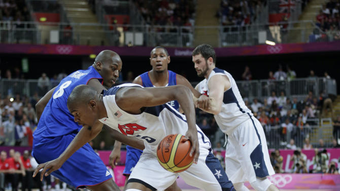 USA's Kevin Durant drives to the basket past France's Ali Traore during the first half of a preliminary men's basketball game at the 2012 Summer Olympics, Sunday, July 29, 2012, in London. (AP Photo/Charles Krupa)