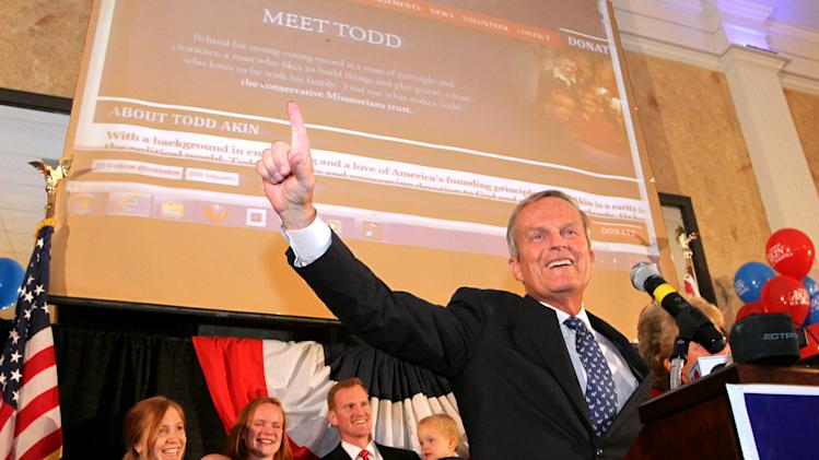 "FILE - In this Aug. 7, 2012 file photo, Todd Akin, GOP Senate candidate from Missouri celebrates winning the primary at his campaign party at the Columns Banquet Center in St. Charles, Mo.  Until this week, Rep. Todd Akin was virtually unknown beyond his district, associated more with his deep religious convictions than any legislative achievements. Long before his comments about women's bodies and ""legitimate rape"" made him a flashpoint in the fall campaign, this congressional backbencher was a favorite among home-schooling organizations and conservative church groups. (AP Photo/St. Louis Post-Dispatch, Christian Gooden) EDWARDSVILLE INTELLIGENCER OUT; THE ALTON TELEGRAPH OUT"