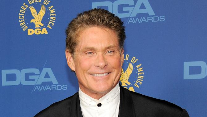 FILE - In this Feb. 2, 2013 file photo, actor David Hasselhoff arrives at the 65th Annual Directors Guild of America Awards in Los Angeles. A convenience store clerk has been critically injured trying to stop the theft of two signs featuring images of actor David Hasselhoff. Authorities say a 36-year-old clerk at a Cumberland Farms in Shelton saw a man put the signs into an SUV early Tuesday, Aug. 20. Police say the worker was struck and dragged by the SUV and landed on his head. Police say the clerk is hospitalized in critical condition, and authorities are looking for the suspects. (Photo by Chris Pizzello/Invision/AP, File)