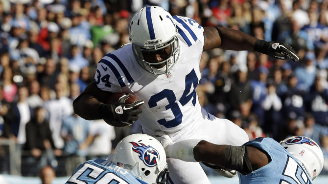 Indianapolis Colts running back Delone Carter (34) jumps into the end zone for a touchdown as Tennessee Titans outside linebackers Akeem Ayers (56) and Zach Brown (55) defend during the second half of an NFL football game, Sunday, Oct. 28, 2012, in Nashville, Tenn. (AP Photo/Mark Humphrey)