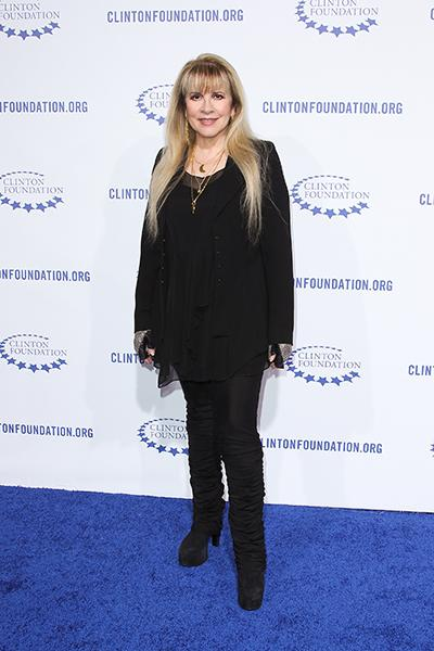 "On the blue carpet at The Clinton Foundation's ""A Decade of Difference"" gala in 2011"