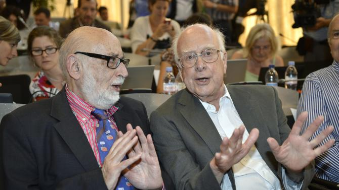 """Belgian  physicist  Francois Englert, left, and British physicist Peter Higgs right, answers journalist's question about the scientific seminar to deliver the latest update in the search for the Higgs boson at the European Organization for Nuclear Research (CERN) in Meyrin near Geneva, Switzerland, Wednesday, July 4, 2012. The head of the world's biggest atom smasher is claiming discovery of a new particle that he says is consistent with the long-sought Higgs boson known popularly as the """"God particle.""""  Rolf Heuer, director of the European Center for Nuclear Research, or CERN, says """"we have a discovery"""" of a new subatomic particle, a boson, that is """"consistent with a Higgs boson.""""  He spoke after two independent teams at CERN said they have both """"observed"""" a new boson that looks just like the one believed to give all matter in the universe size and shape.  (AP Photo/Keystone/Martial Trezzini)"""