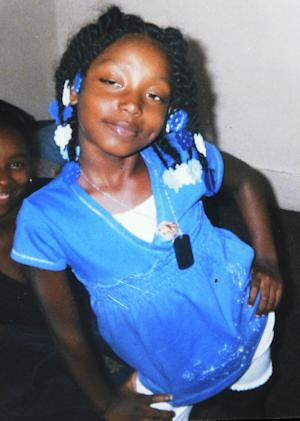 FILE - This undated family photo shows Aiyana Stanley-Jones, 7, who was shot and killed Sunday, May 16, 2010, by a shot from a Detroit police officer during a raid to arrest a murder suspect. A man rounding up his puppies late at night says he warned Detroit police that children were inside a house they were about to raid in a hunt for a murder suspect that left a 7-year-old girl dead. Aiyana Stanley-Jones was accidentally shot and killed during the raid by Detroit Officer Joseph Weekley, who is on trial for involuntary manslaughter in Aiyana's death. (AP Photo/Family Photo via The Detroit News) NO SALES; DETROIT FREE PRESS OUT