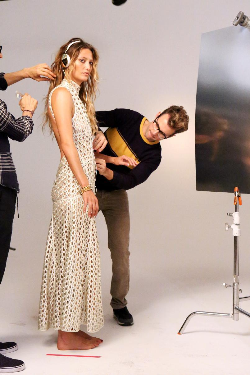 "This undated publicity image released by Bravo shows stylist Brad Goreski adjusting an outfit in a scene from ""It's a Brad, Brad World,"" in Los Angeles, airing Wednesdays at 10 p.m. EST. (AP Photo/Bravo, Evans Vestal Ward)"