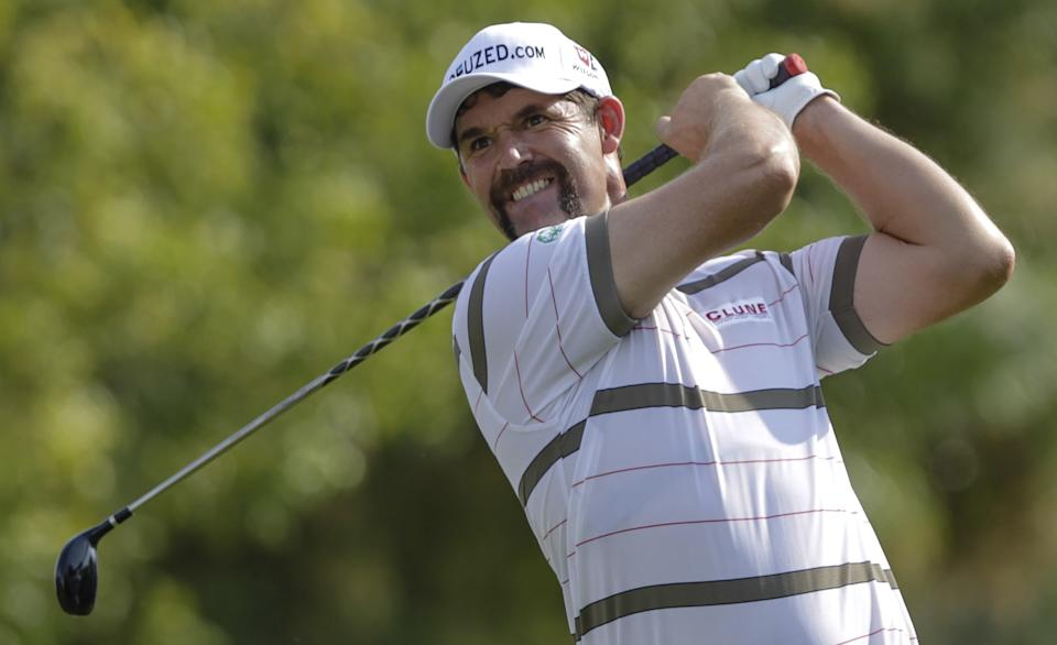 Padraig Harrington of Ireland plays a ball on the 2nd hole during round one of DP World Golf Championship in Dubai, United Arab Emirates, Thursday Nov. 22, 2012. (AP Photo/Francois Steenkamp)