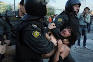 Russian Police officers detain opposition supporters during a rally in Moscow. Baton-wielding riot police roughly broke up a Moscow protest rally Sunday on the eve of Vladimir Putin's return for a third Kremlin term, arresting more than 400 people including top opposition leaders