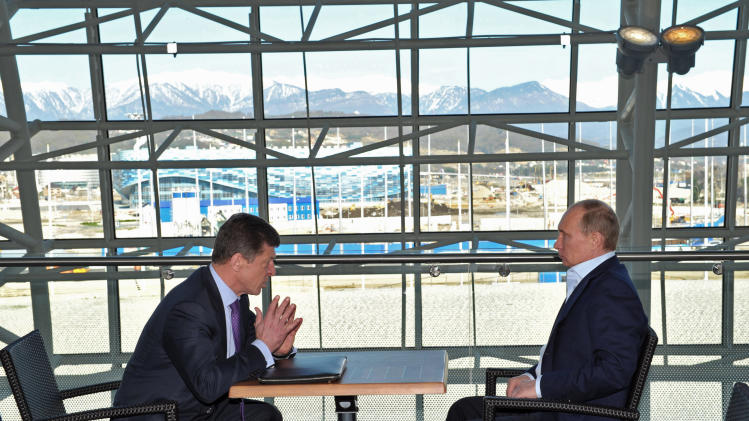 Russian President Vladimir Putin, right, meets with Deputy Prime Minister Dmitry Kozak,  in the Bolshoi Ice Dome in the Black Sea resort of Sochi, Russia, Saturday, March 30, 2013. (AP Photo/RIA-Novosti, Alexei Nikolsky, Presidential Press Service)