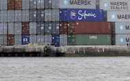 <p>               In this Tuesday, Jan. 8, 2013 photo, shipping containers are stacked at the Port of Miami. U.S. wholesalers boosted their stockpiles in January by the largest amount in 13 months, even though their sales dropped sharply. (AP Photo/Wilfredo Lee)