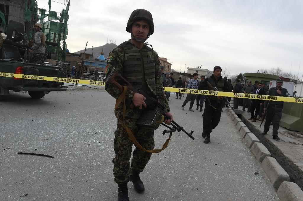 Suicide bomber hits Kabul as Taliban warn on US troop pullout