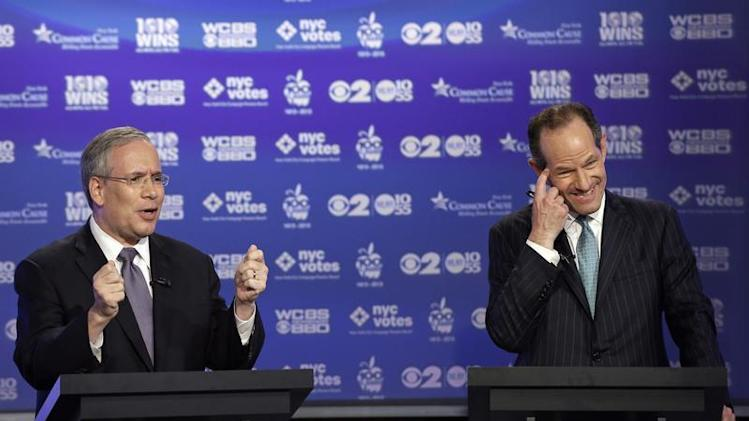 Manhattan borough president Scott Stringer and former New York Governor Eliot Spitzer, both Democrats, participate in a primary debate for New York City comptroller in the WCBS-TV studios in New York