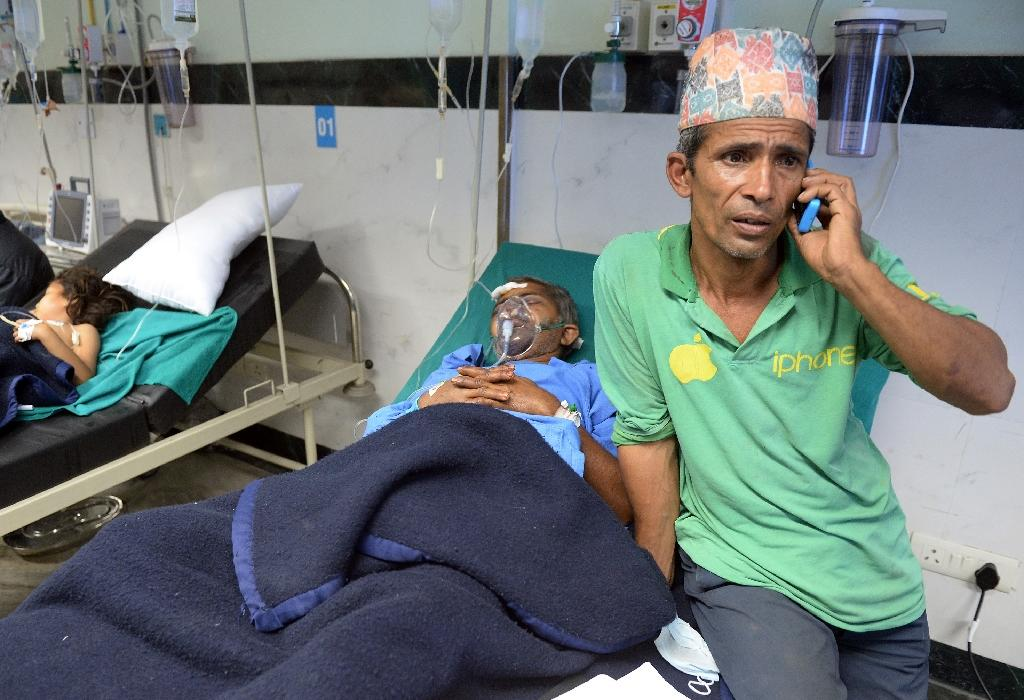 Nepal hospitals overflowing, rural towns cut off: aid groups