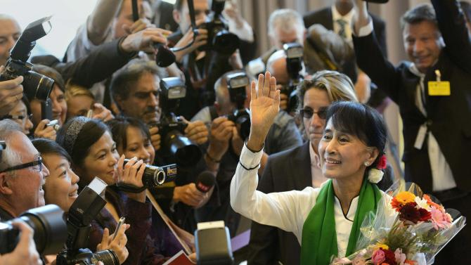 CORRECTS PHOTOGRAPHER'S NAME - Aung San Suu Kyi, the Myanmar opposition leader, left, arrives at the 101st International Labor Organization, ILO, Conference at the European headquarters of the United Nations in Geneva, Switzerland, Thursday, June 14, 2012. Suu Kyi visits Switzerland, Norway, Ireland, Britain and France from June 13, 2012 to June 29, 2012. (AP Photo/Keystone, Laurent Gillieron)