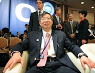 "Deputy Governor of the People's Bank of China Yi Gang takes his seat at the International Monetary and Financial Committee meeting in Tokyo. China said Saturday the failure by Washington and Tokyo to fix their fiscal problems was hurting the global economy, as it called for ""bold, swift and decisive action"" to reverse a slowdown"