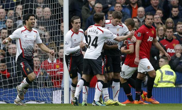 Liverpool's Gerrard celebrates scoring a penalty against Manchester United during their English Premier League soccer match in Manchester