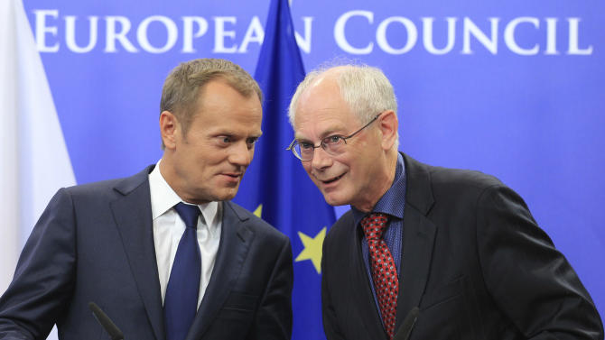 FILE- In this Sept.12, 2011 file photo European Council President Herman Van Rompuy, right, and Poland's Prime Minister Donald Tusk address the media, at the European Council building in Brussels. Tusk was chosen by European leaders to be the next president of the European Council. European Union nations were looking at sporting sanctions to punish Russia for its involvement in the Ukraine crisis but diplomats said Wednesday Sept.3, 2014 the immediate targeting of high-profile events like the 2018 World Cup is unlikely at this stage. (AP Photo/Yves Logghe,file)