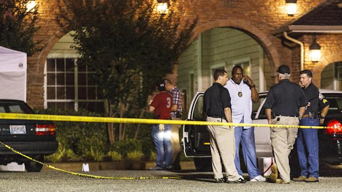 Auburn Police cordon off the scene at University Heights apartment complex on West Longleaf Drive, early Sunday, June 10, 2012, in Auburn, Alabama. Auburn's Police Chief Tommy Dawson  says several people have been shot at an apartment complex in the city, but he had no immediate details to release.  (AP Photo/Opelika-Auburn News, Vasha Hunt)