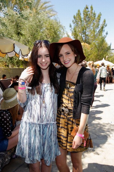 PALM SPRINGS, CA - APRIL 14: Actors Lily Collins and Emma Watson attend Mulberry BBQ Pool Party at Coachella at the Parker Palm Springs on April 14, 2012 in Palm Springs, California. (Photo by Donato