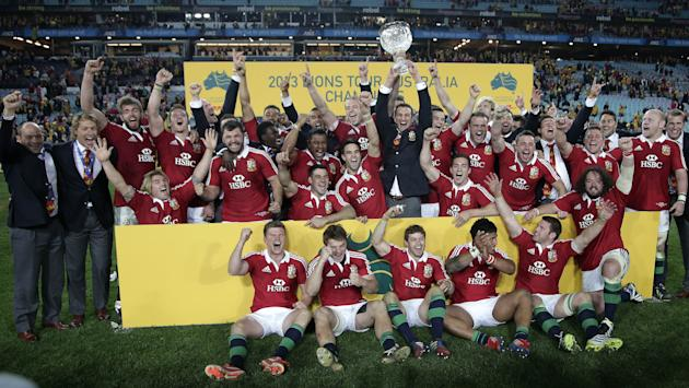 FILE - In this Saturday July 6, 2013 file photo, British and Irish Lions' team players celebrate their win over Australia in the final match of their 3-game rugby union test match series in Sydney