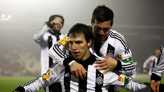 Partizan Belgrade's players celebrate