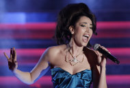 FILE This Saturday, Feb. 18, 2012 file photo shows Italian singer Nina Zilli performing during the 62nd edition of the Sanremo Song Festival, in Sanremo, Italy. The annual Eurovision Song Contest, a televised pan-European extravaganza viewed by some 125 million people worldwide that is now entering its 57th year. The winner is picked by juries and television viewers across the continent. Nina Zilli will sing &quot;Out of Love&quot; is a brassy, lively ode by Italy&#39;s Nina Zilli that could spring a surprise. (AP Photo/Luca Bruno)