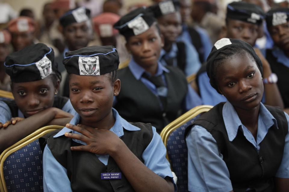 School children attends the unveiling of a Lagos-themed Monopoly board game in Lagos, Nigeria, Tuesday, Dec. 11, 2012/ Nigeria's largest city of Lagos is no boardwalk, but now Monopoly is taking an inspiration from the sprawling chaos. (AP Photo/Sunday Alamba)