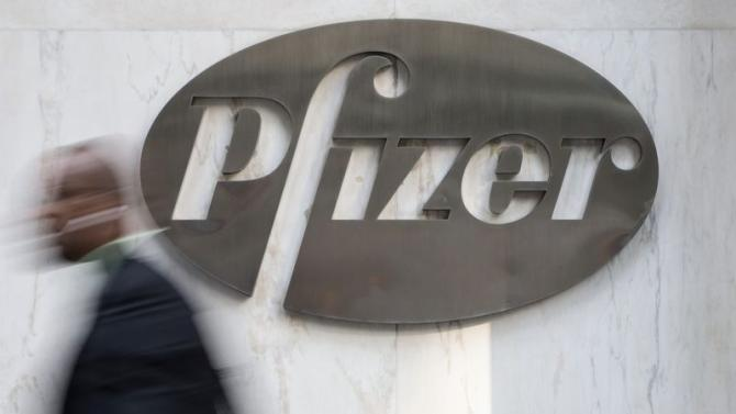 A man walks past Pfizer's world headquarters in New York