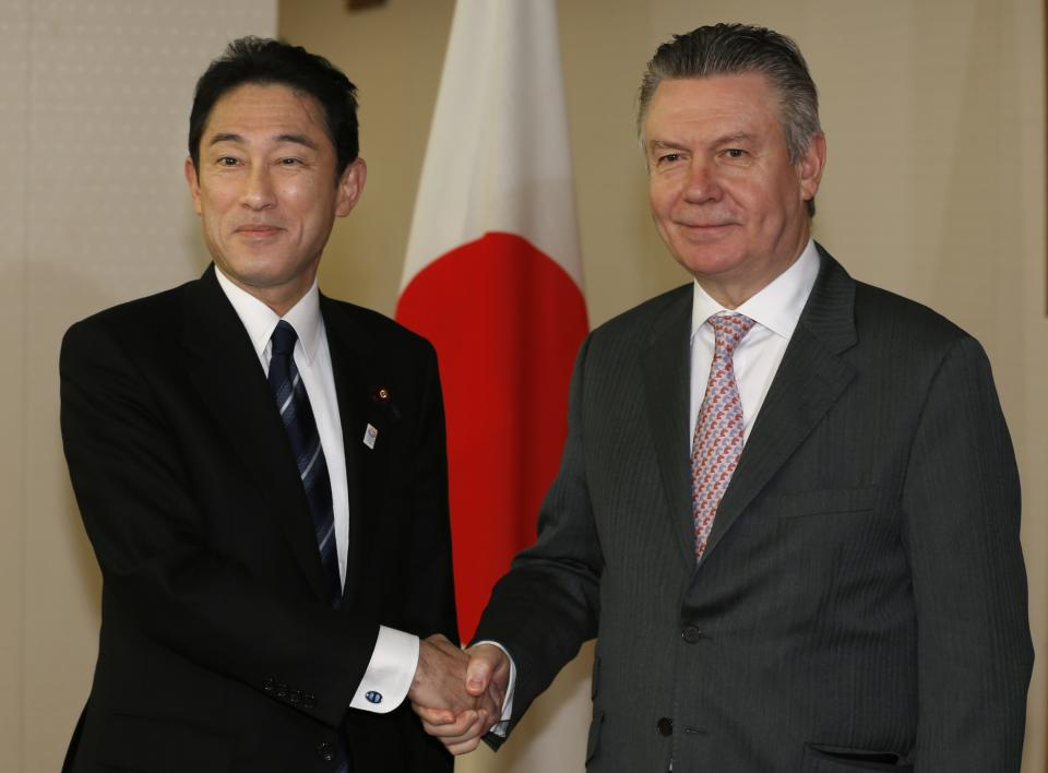 European Trade Commissioner Karel De Gucht, right, and Japanese Foreign Minister Fumio Kishida pose for photographers prior to their meeting at the Foreign Ministry in Tokyo, Monday, March 25, 2013. De Gucht is in Tokyo and meeting with Japanese government and business officials as scheduled. (AP Photo/Shizuo Kambayashi)