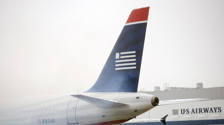 File photo of an US Airways plane emitting exhaust at Philadelphia International Airport