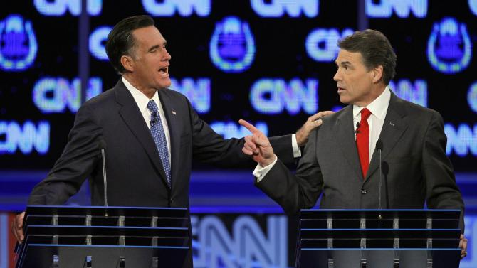 Republican presidential candidates former Massachusetts Gov. Mitt Romney, left, and Texas Gov. Rick Perry are seen during a Republican presidential debate Tuesday, Oct. 18, 2011, in Las Vegas. (AP Photo/Chris Carlson)
