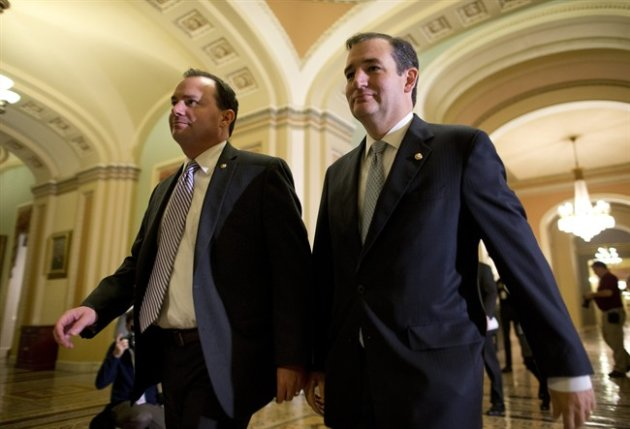 Sen. Mike Lee, R-Utah, left, and Sen. Ted Cruz, R-Texas, walk to the Senate floor to vote on a bill to raise the debt ceiling and fund the government on Capitol Hill on Wednesday, Oct. 16, 2013 in Washington. (AP Photo/ Evan Vucci)