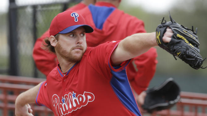 Philadelphia Phillies pitcher Chad Billingsley throws during a spring training baseball workout, Friday, Feb. 27, 2015, in Clearwater, Fla. (AP Photo/Lynne Sladky)