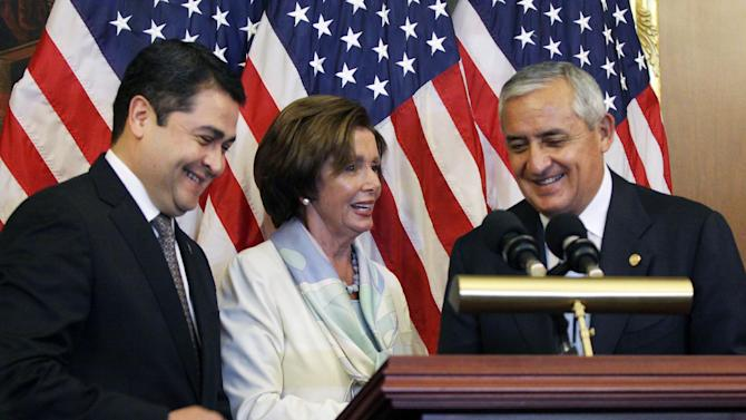 House Democratic Leader Nancy Pelosi, D-Calif., center, is seen with Guatemalan President Otto Molina, right, and Honduran President Juan Hernández on Thursday, July 24, 2014 on Capitol Hill in Washington. The Obama administration is weighing giving refugee status to young people from Honduras as part of a plan to slow the influx of unaccompanied minors arriving at the U.S.-Mexico border, White House officials said Thursday. The plan would involve screening youths in Honduras, one of the world's most violent nations, to determine whether they qualify for refugee status. (AP Photo/Lauren Victoria Burke)