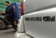 A Shanghai General Motors (GM) vehicle is parked on a street in Shanghai in May 2012. US auto giant General Motors said Thursday its China sales for the first half of this year reached a record 1.42 million vehicles, despite an economic slowdown in the world's biggest car market