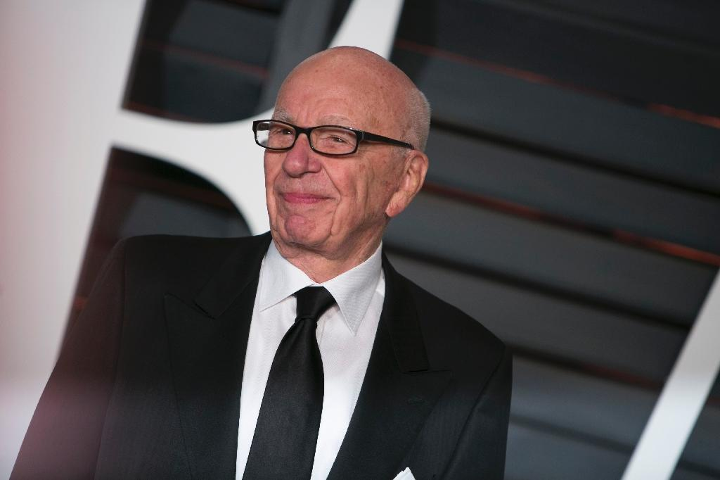 Murdoch says sorry for 'real black president' tweet