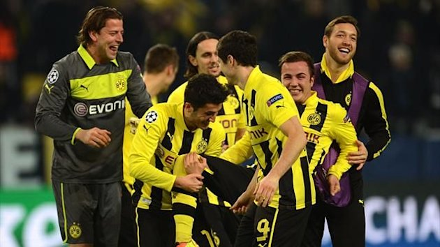 Mario Gotze celebrates his goal with Borussia Dortmund team-mates in the Champions League against Shakhtar Donetsk (AFP)