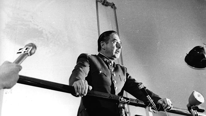 """FILE - In this 1974 file photo, Chilean dictator Gen. Augusto Pinochet speaks at an informal press conference in Santiago, Chile. Newly declassified U.S. documents indicate that Pinochet planned to use violence to annul the referendum that ended his brutal regime in 1988. The formerly secret documents posted by the independent U.S. National Security Archive on Friday, Feb. 22, 2013 showed U.S. officials warning Chilean leaders against violence if Pinochet tried to use force to stay in power if people voted against eight more years of his rule. They also show U.S. officials and agencies backed the anti-Pinochet campaign portrayed in the Oscar-nominated film """"No,"""" even though the U.S. government also had tried to undermine the socialist government Pinochet had overthrown. (AP Photo, File)"""