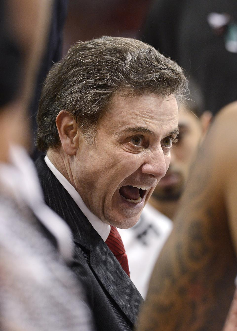 Louisville coach Rick Pitino talks to his players during a timeout in the second half of an NCAA college basketball game against South Florida on Saturday, Jan. 12, 2013, in Louisville, Ky. Louisville defeated South Florida 64-38. (AP Photo/Timothy D. Easley)