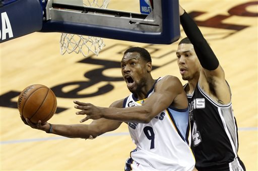 Memphis Grizzlies guard Tony Allen (9) drives to the basket as San Antonio Spurs guard Danny Green (4) defends during the half in Game 3 of the Western Conference finals NBA basketball playoff series,