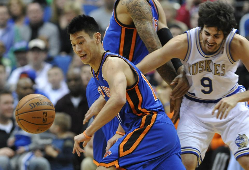 New York Knicks' Tyson Chandler, center, sets a pick on Minnesota Timberwolves' Ricky Rubio, right, of Spain, as Knicks' Jeremy Lin, left, chases the loose ball in the first half of an NBA basketball game on Saturday, Feb. 11, 2012, in Minneapolis. (AP Photo/Jim Mone)