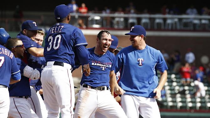 Rangers rally for 2 runs in 9th, beat Angels