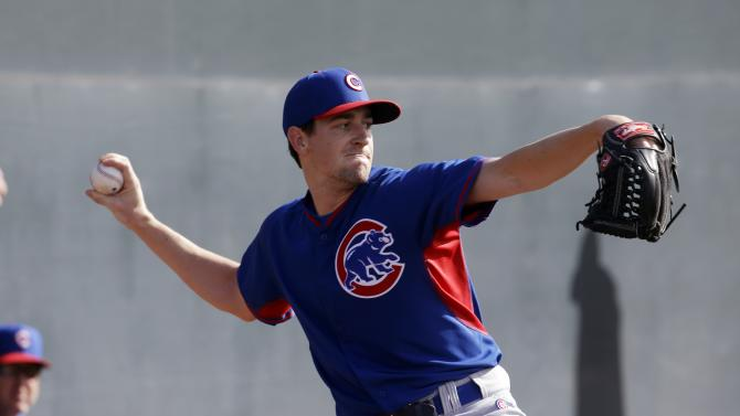 FILE - In this Feb. 21, 2015, file photo, Chicago Cubs' Kyle Hendricks throws during a spring training baseball workout in Mesa, Ariz. Kyle Hendricks was a pleasant surprise after he was promoted to the Chicago Cubs last season, drawing raves for his control and quick pace on the mound. Now the Dartmouth-educated right-hander looks for a similar encore in the No. 4 slot of an improved rotation.(AP Photo/Morry Gash, File)