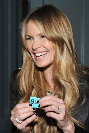 Elle Macpherson spotted wearing a diamond ring at a private dinner for Barry the Dog fitness trainer ahead of his husky expedition across the Arctic at 3 Cromwell Road in London on March 26, 2013 -- Getty Images
