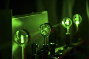 Handout photo of cloaking device using four lenses developed by University of Rochester physics professor Howell and graduate student Choi is demonstrated in Rochester