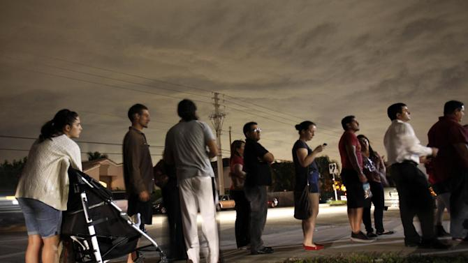 FILE - This Nov. 6, 2012 file photo shows voters lined up in the dark to beat the 7:00 p.m. deadline to cast their ballots at a polling station in Miami.  It's not just the economy. It's the demographics _ the changing face of America. The 2012 elections drove home trends that have been embedded in the fine print of birth and death rates, immigration statistics and census charts for years.  America is rapidly getting more diverse. And, more gradually, so is its electorate.  Non-whites made up 28 percent of the electorate this year, up from 21 percent in 2000, and much of that growth is coming from Hispanics. (AP Photo/Wilfredo Lee, File)