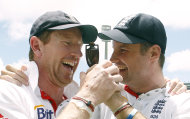 CORRECTS SPELLING OF URN - England's cricket captain Andrew Strauss, right, holds the Ashes urn as he celebrates with Paul Collingwood after winning the 5th Ashes Test Match against Australia in Sydney, Australia, Friday, Jan. 7, 2011.