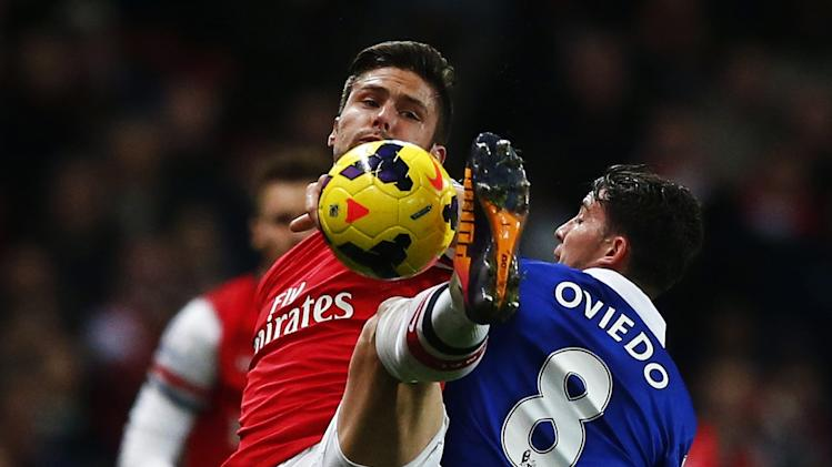Everton's Oviedo challenges Arsenal's Giroud during their English Premier League soccer match at The Emirates in London