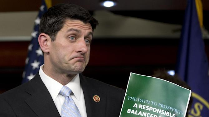 House Budget Committee Chairman Rep. Paul Ryan, R-Wis., holds up a copy of the 2014 Budget Resolution as he speaks during a news conference on Capitol Hill in Washington, Tuesday, March 12, 2013. (AP Photo/Carolyn Kaster)