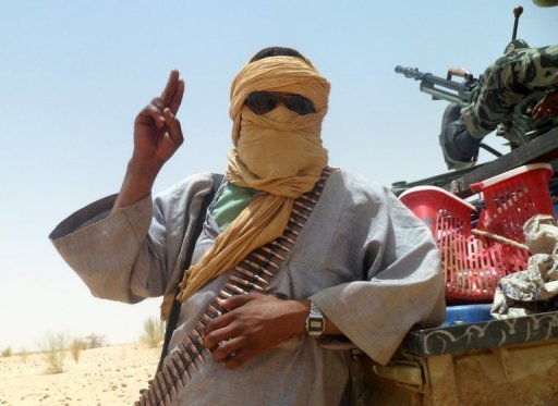<p>An Islamist rebel of Ansar Dine makes a victory sign near Timbuktu, rebel-held northern Mali. Islamist rebels in northern Mali took hoes and chisels to the tombs of ancient Muslim saints in Timbuktu for a second day Sunday, ignoring international pleas to halt their campaign of destruction.</p>