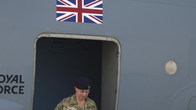 Britain's Prime Minister David Cameron, right, accompanied by General Sir David Richard, Chief of the Defence staff, arrives for a visit at Camp Bastion, outside Lashkar Gah, the provincial capital of Helmand province in south Afghanistan, Monday, July 4, 2011. (AP Photo/Lefteris Pitarakis, pool)